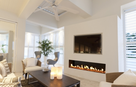 Frameless linear front facing fireplace with TV above