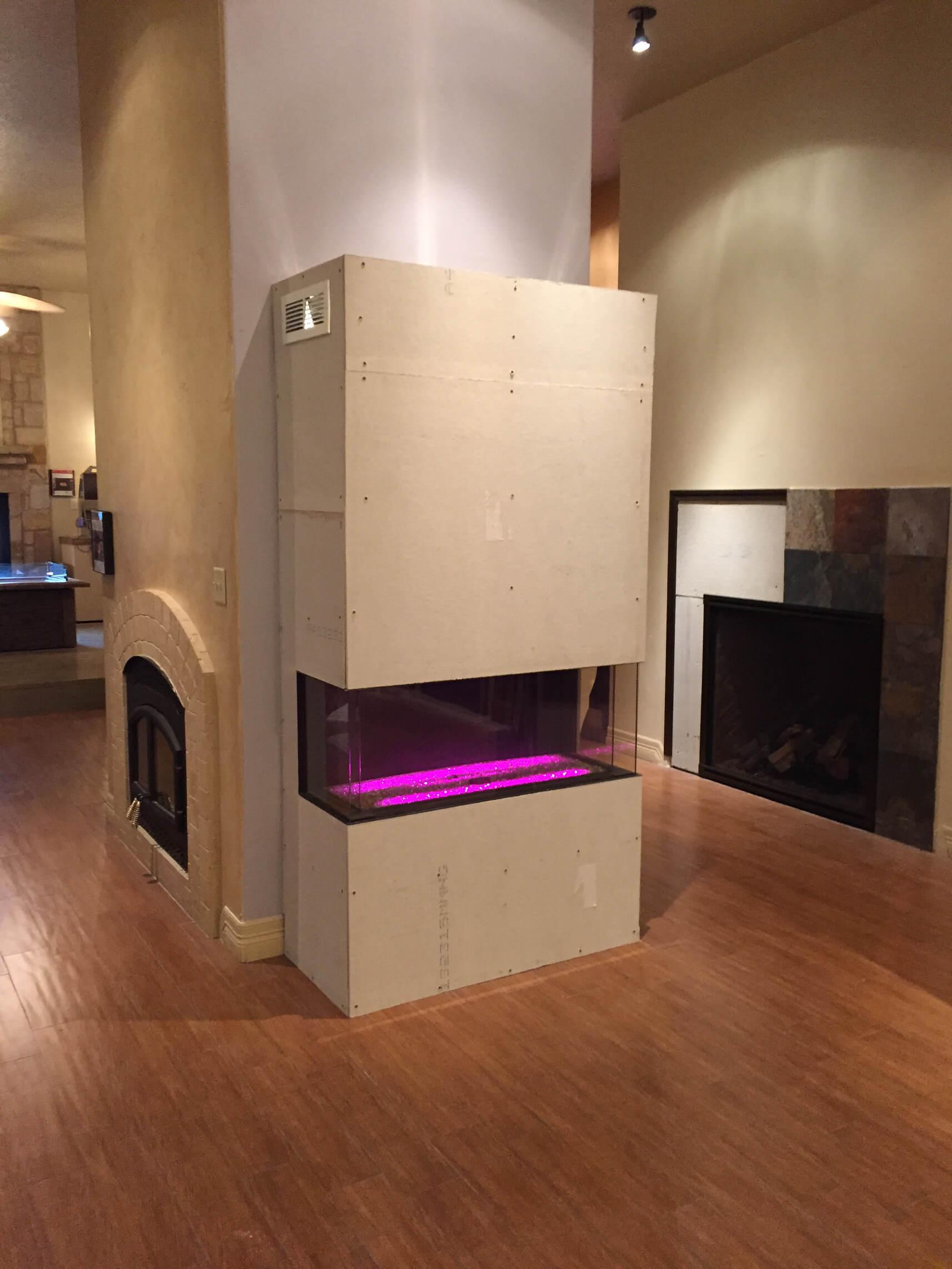 Frameless linear double corner fireplace
