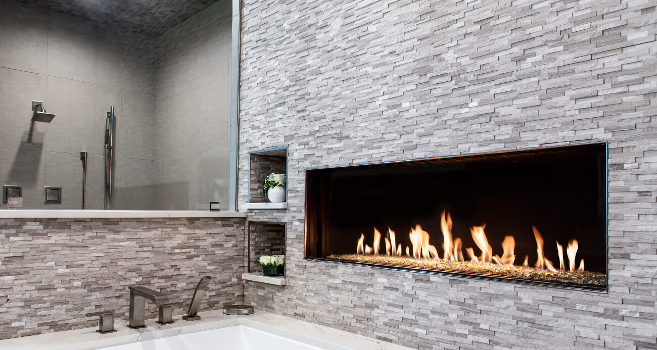 front facing modern fireplace above bathtub