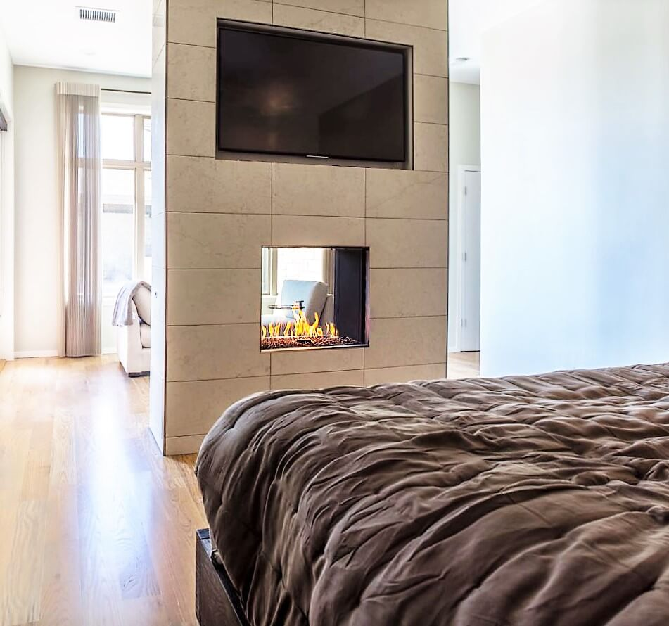 see through modern fireplace in bedroom