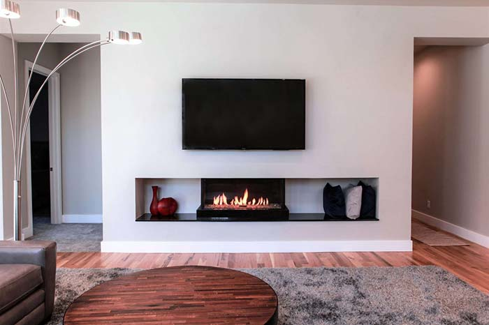 Flare Front fireplace with mounted TV