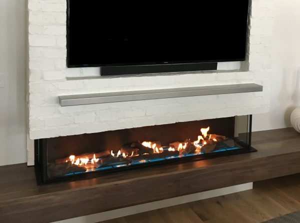 double corner three sided fireplace with LED lights