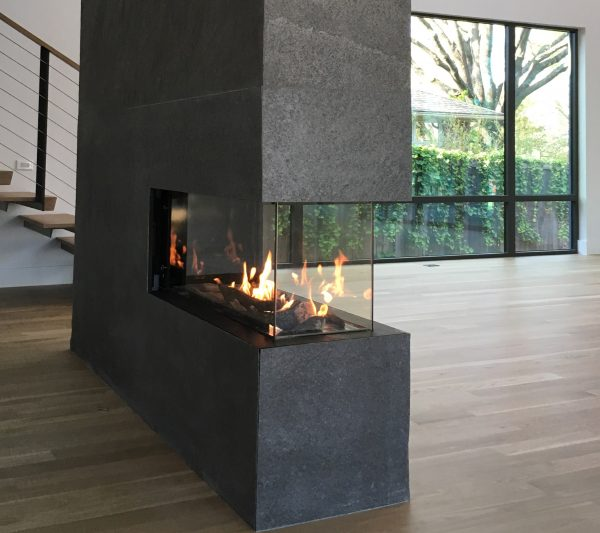 Peninsula three sided modern fireplace