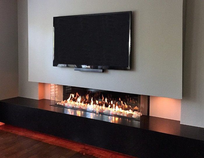 Linear frameless double corner fireplace burning