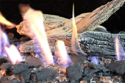 Driftwood fireplace media over fire glass