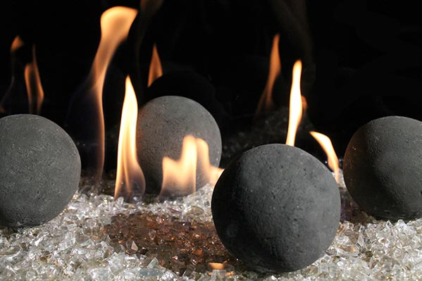 Black Stone Balls burning in a modern fireplace. Nice yellow flame in front of the ball
